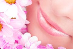 Smile of woman with flowers Royalty Free Stock Photography