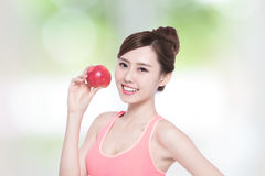 Smile woman hold apple Stock Image