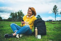 Smile woman holding in female hands gadget technology, tourist young girl text message on background green grass using mobile. Smartphone, hiker enjoy stock image