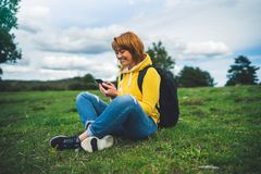 Smile woman holding in female hands gadget technology, tourist young girl text message on background green grass using mobile. Smartphone, hiker enjoy stock photos