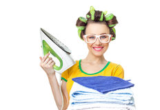 Smile woman holding iron and towels. Stock Photos