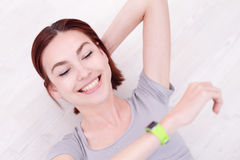 Smile woman look smart watch Stock Photo