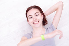 Smile woman look smart watch Stock Images