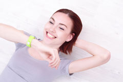 Smile woman look smart watch Royalty Free Stock Photo