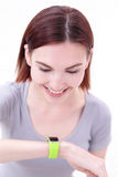 Smile woman look smart watch Royalty Free Stock Photos