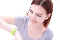 Smile woman look smart watch Royalty Free Stock Images