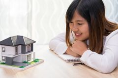 Smile woman looking at home and getting ready to sign contract f stock photography