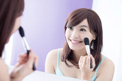 Smile woman with makeup brushes Royalty Free Stock Photos