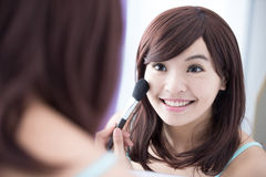 Smile woman with makeup brushes Stock Photos