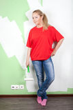 Smile woman with paint roller in hand Stock Images