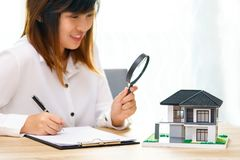 Smile woman searching for new home or inspecting homes before bu stock photos