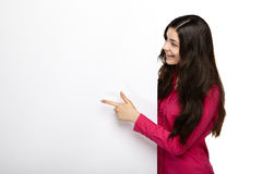 Smile woman standing pointing her finger at board Royalty Free Stock Photography