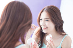Smile woman with teeth floss. Close up of Smile woman clear teeth by floss and look mirror. great for health dental care concept. asian beauty Stock Images