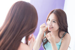 Smile woman with teeth floss. Close up of Smile woman clear teeth by floss and look mirror. great for health dental care concept. asian beauty Royalty Free Stock Photography
