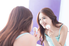 Smile woman with teeth floss. Close up of Smile woman clear teeth by floss and look mirror. great for health dental care concept. asian beauty Stock Image
