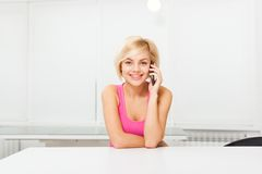 Smile woman using phone call sitting table Royalty Free Stock Image