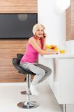 Smile woman using phone call sitting table Royalty Free Stock Images