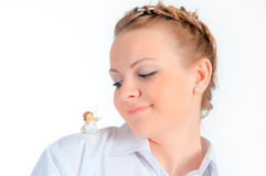 Smile woman on a white background with a small toy Stock Photography