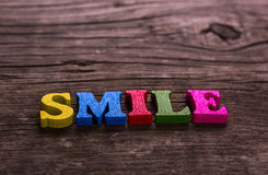 Smile word made of wooden letters Royalty Free Stock Photo