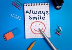Always smile word on notebook Stock Photos