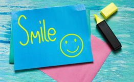 Smile word and smiley Inspirational quote. stock photography