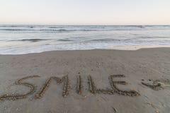 Smile. Word Smile written on the seashore royalty free stock photo
