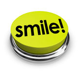 Smile Word Yellow Button Funny Humor Good Spirits. Smile word on a yellow 3d button sharing funny humor and good spirits to spread cheer Stock Photo