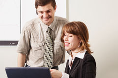 Smile worker. Group of 2 business people working together in the office Royalty Free Stock Photo