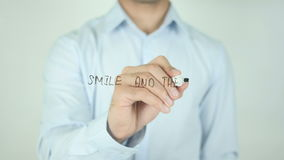 Smile And The World Smiles With You, Writing On Transparent Screen. Man writing stock video footage