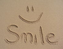 Smile written in the sand Stock Photos