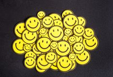 Smile yellow faces on the table Stock Image