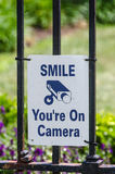 Smile you are on Camera Sign Stock Images