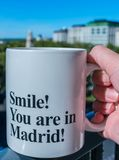 Smile! You are in Madrid! Coffee cup royalty free stock image