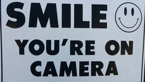 Smile youre on camera. I know some people refuse to smile on camera so heres a great picture for them Stock Photo