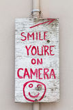 Smile you're on Camera Sign Stock Photos