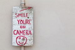 Smile you're on Camera Sign Royalty Free Stock Photos