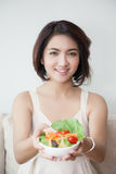 Smile young beautiful women holding a bowl of salad Royalty Free Stock Photography