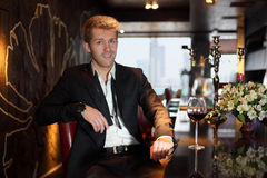 Smile man in a black suit at the bar Royalty Free Stock Photo