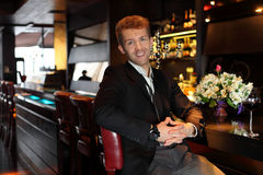 Smile man in a black suit at the bar Royalty Free Stock Image