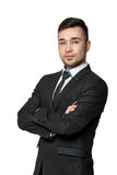 Smile young man in business suit, arms crossed his chest, isolated on a white background Stock Photos
