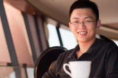 Smile young man at coffee shop royalty free stock images