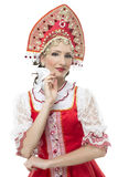 Smile young woman hands on hips portrait in russian traditional costume -- red sarafan and kokoshnik. Stock Image