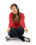Smile young woman listening music Stock Images