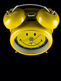 Smiled alarm clock Stock Images