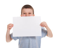 Smiled boy with blank paper Royalty Free Stock Photos