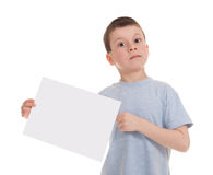 Smiled boy with blank sheet Royalty Free Stock Photography