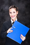 Smiled business woman with files Stock Photography