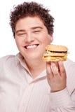 Smiled chubby and hamburger. Smiled chubby holding a hamburger, isolated on white Stock Photography