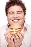 Smiled chubby and hamburger. Happy chubby holding a hamburger, isolated on white Stock Photo