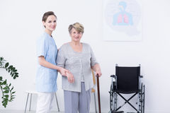 Smiled elder woman with cane Royalty Free Stock Images